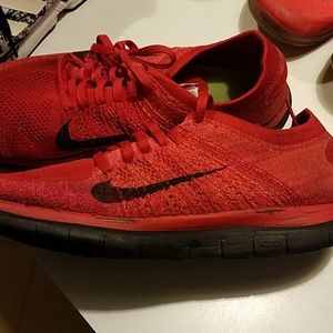 Red Nike shoes used
